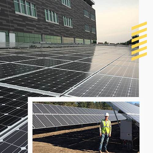 Worker standing by solar panels